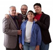 image of extended family  - An extended Indian family of grandfather son and grandsons in a studio setting - JPG