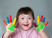 picture of messy  - Cute little girl with painted hands - JPG
