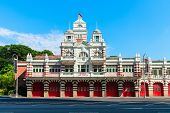 image of fire-station  - Vintage retro fire station building with red gates and brick walls - JPG