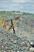 stock photo of iron ore  - Excavator on the iron ore opencast mining site - JPG