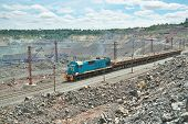 foto of iron ore  - Cargo train delivering iron ore from the opencast - JPG