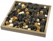 picture of laxatives  - An assortment of liquorice candies in a wooden bowl over white - JPG