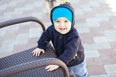 picture of cute innocent  - Cute little baby boy face near chair outdoor - JPG