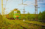 picture of murmansk  - Electric freight train crossing the Russian countryside as it approaches Polyarnye Zori in the Murmansk region of Russia - JPG
