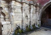 image of fountains  - Rimondi Fountain in the city of Rethymno on the island of Crete Greece - JPG