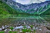 image of avalanche  - Avalanche lake with reflection in Glacier National Park - JPG