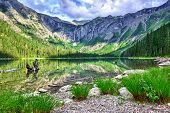 picture of avalanche  - gorgeous sunlit Avalanche lake with reflection in Glacier National Park - JPG
