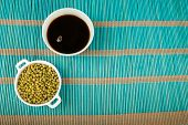 image of soy sauce  - Soy sauce and soy beans on a bamboo mat - JPG