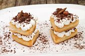 pic of nack  - Puff pastry with cream and chocolate in a white plate - JPG