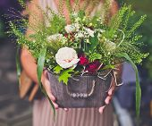 pic of harvest  - Woman hands holding a metal basket of flowers - JPG