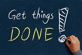 picture of blue things  - Get things done on blue chalkboard with the hand of businessman - JPG