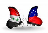 stock photo of samoa  - Two butterflies with flags on wings as symbol of relations Syria and Samoa - JPG