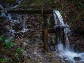 stock photo of water-mill  - Water mill in wood on the creek - JPG