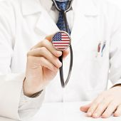 picture of stethoscope  - Doctor holding stethoscope with flag series  - JPG