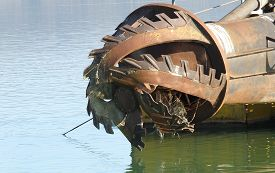 foto of dredge  - rotor with blade of a big dredge in a channel - JPG
