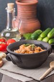 stock photo of buckwheat  - Buckwheat with meat and vegetables on wooden table rustic style - JPG