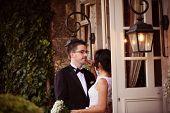 image of windows doors  - Bride and groom near door with windows - JPG