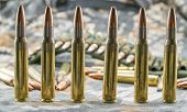 stock photo of hollow point  - view of golden hollow point ammunition for rifle - JPG
