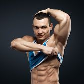 picture of abdominal muscle man  - Bodybuilder showing his press - JPG