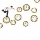 foto of running-late  - Geeky young businessman running late against clocks - JPG