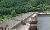 foto of dam  - The Stone Built Top of a Large Reservoir Earth Dam - JPG