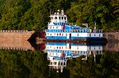 foto of barge  - Blue and white tugboat pushing barge on the Warrior River in Alabama - JPG