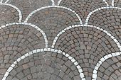foto of cobblestone  - Cobblestones pavement street with decoration in Italy - JPG