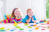 foto of preschool  - Preschooler child playing with colorful toy blocks - JPG