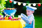 picture of bbq party  - Children grilling meat - JPG