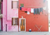 stock photo of early morning  - Early morning in BUrano street with linen - JPG