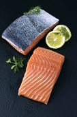 stock photo of slab  - Salmon Fillet on a slab of Slate - JPG