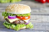 pic of hamburger-steak  - Hamburger on vintage wooden board closeup with spices - JPG