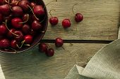 foto of black-cherry  - Bowl with black cherry rustic selective focus horizontal top view - JPG