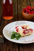 stock photo of fruit bowl  - Vertical photo of white plate with single portion of fresh cherry pie with several herb leaves - JPG