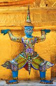 picture of buddha  - Giant Buddha in Wat Phra Kaeo Temple of the Emerald Buddha in Bangkok Thailand - JPG
