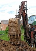 stock photo of excavator  - working with excavator at road construction site - JPG