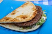 image of souvlaki  - Greek pita with meat salad tomato and sauce - JPG