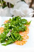 picture of rocket salad  - fresh salmon carpaccio sushi sashimi with arugula rocket salad and caper on top - JPG