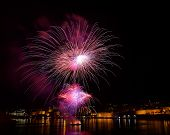 Постер, плакат: Colorful fireworks close explode in Malta in dark sky Malta fireworks festival 4 July Independence