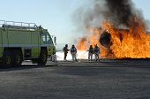 foto of firehose  - Firefighters train for battling an aircraft fire - JPG