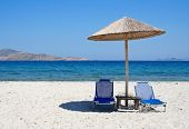 Greece. Kos Island. Two Chairs And Umbrella On The Beach