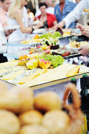 picture of buffet catering  - people choosing food from table on catering and buffet party on business seminar conference or wedding - JPG