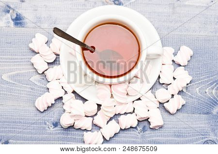 poster of Tea Cup With Dipped Teabag And Marshmallows. Process Of Drink Brewing In Mug, Top View. Mug Filled W