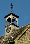 stock photo of pigeon loft  - old house roof with clock tower and pigeons - JPG