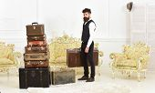 Macho Elegant On Strict Face Carries Vintage Suitcase. Luggage And Relocation Concept. Man, Butler W poster