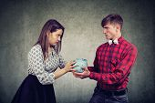 Finances In Divorce Concept. Angry Wife And Husband Can Not Make Settlement Holding Piggy Bank Looki poster