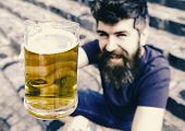 Guy Raising Up Glass With Draught Beer. Hipster On Smiling Face Drinks Beer Outdoor. Cheers Concept. poster
