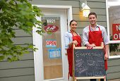 picture of apron  - Cafe owners in front of shop - JPG