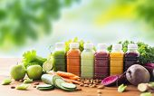 healthy eating, drinks, diet and detox concept - plastic bottles with different fruit or vegetable j poster