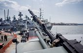 Machine Gun On Modern Military Battleship. Modern Russian Military Battleships On Background. Russia poster